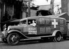 """Riette Kahn is shown at the wheel of an ambulance donated by the American movie industry to the Spanish government in Los Angeles, California, on Sept. 18, 1937. The Hollywood Caravan to Spain will first tour the U.S. to raise funds to """"help the defenders of Spanish democracy"""" in the Spanish Civil War."""