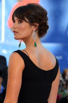 I don't usually go gaga over non-costume jewelry, but WOW. Also love the loose updo and the back of the bodice.