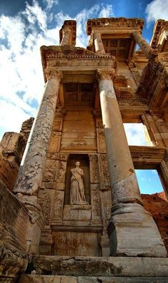 The Library of Celsus ~ Ephesus, Turkey : The exaggerated entrance was faced east so that the reading rooms containing nearly 12,000 scrolls could make best use of the morning light, and would have stood as a sign of the bustling Roman metropolis' status in the empire.