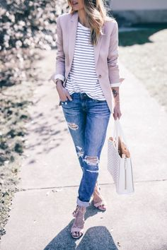 Jess Ann Kirby is rocking this classic spring style of distressed denim jeans, a striped tee, and a pastel coloured blazer. We love this cute and casual spring look! Blazer: Reiss, Jeans: Revolve, Sandals: Dune.