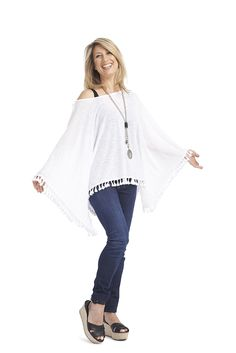Fun & flowing light weight fringed poncho!! Great overlay piece!