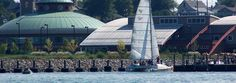 """Our catamaran """"Taco the Town"""" sails past our waterfront facility on Presque Isle Bay, Erie PA."""