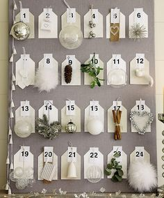 DIY Advent Calendar: Elegant ornaments displayed on a light grey fabric covered board.
