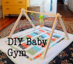 DIY Baby Gym -similar to what we made. We pot chains of the way down to keep it from falling flat. - Tap the pin if you love super heroes too! Cause guess what? you will LOVE these super hero fitness shirts! Wood Baby Gym, Baby Gym Mat, Diy Baby Gym, Baby Play, Baby Toys, Newborn Toys, Baby Activity Gym, Diy Bebe, Play Gym