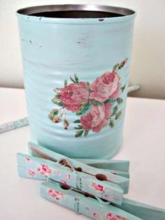 Decoupaged coffee can...toilet tissue holder...?