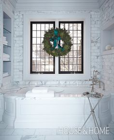 Bathrooms become instantly party ready with the simple addition of a fragrant pine wreath.   Photographer: Angus Fergusson   Designer: Betty Theodoropoulos