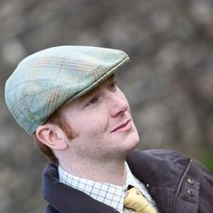Hunters Tweed Golspie Cap In Eribole Tweed Flat cap with deep back and crown Finished in the traditional way with Hessian interlining and hand-sewn