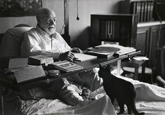 Henri Matisse and his cats Minouche and Coussi