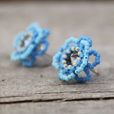 Delicate blue flower earrings with sterling silver studs. Beadwork earrings are made with beautiful shiny Swarovski crystal in the middle. Unique piece of jewerly.