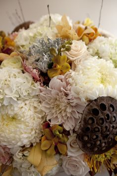 Fall wedding bouquet - twilight colors - dusty blue, dusty rose, dusty mustard, and cream to tie it all together and give it elegance and contrast.  Also like the punches of brown.