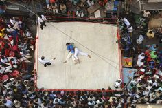 Wrestlers fought during a match in Kolkata, India, Thursday. (Reuters)