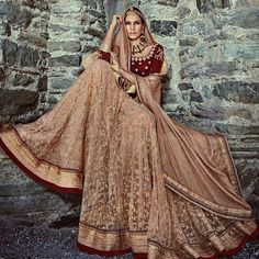 """""""HOT SELLER: Check out our 'Maroon and Beige Net Lehenga' - available for $225 USD @ Lashkaraa.com!"""""""