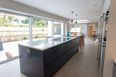 This kitchen was designed with the garden in mind. The understated design, by Planet Furniture, allows the focus to be on the open space when the sliding doors are open. Kitchen Furniture, Sliding Doors, Bespoke, Design Ideas, Interior Design, Space, Garden, Home Decor, Taylormade