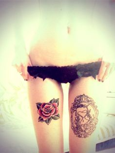 Love this rose thigh tattoo and the hourglass thigh tattoo