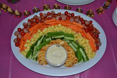 Rainbow party vegetable / savoury / savory dip platter. Also tiny teddy racing cars in the background.