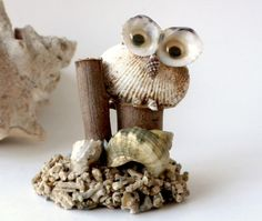 This is a sea shell art owl figurine made in Taiwan ROC. It has a coral bit base and googly eyes. Measures: 3.5 inches high x 3 inches across
