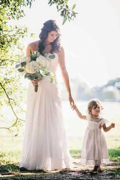 Real bride Lindsey and her beautiful daughter Lola Gray waking to the Groom. Rustic and charming Alabama Wedding!