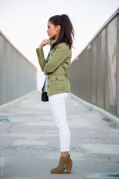 green jacket with white skinny jeans and booties