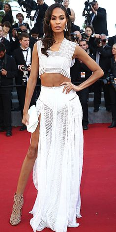 The Best and Boldest Looks from the Cannes Red Carpet! | JOAN SMALLS | in very fancy lingerie – sorry, a white two-piece crochet gown – nude heels, giant earrings and a white clutch at the Youth premiere.