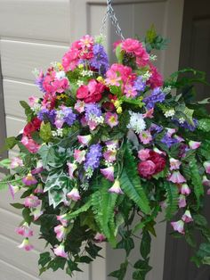 Hanging basket with artificial petunias & geranium