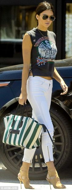 Kendall's a doll! Kendall Jenner stepped out in style when she met her pal Justin Bieber t...