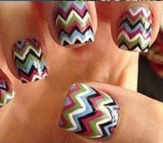 Multicolored zig-zag tribal nails.