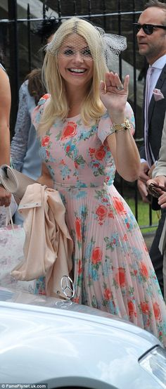Pretty in pastels: Holly looked stunning in her tea dress, leaving her blonde locks down a...
