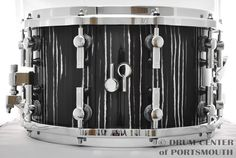Sonor SQ2 Birch Snare Drum 8x14 Ebony White Stripes   Shell Material - Heavy Birch Shell Finish - Ebony White Stripes High Gloss Hoops - Die Cast, chrome plated Lugs - Single lugs, chrome plated Snare Strainer - Dual Glide SQ2 Logo - Chrome plated Snare Wire - 24 Wires; 0.5 mm, Steel Serial number - 5145419  Purchase Here:  http://www.drumcenternh.com/sonor-sq2-birch-snare-drum-8x14-ebony-white-stripes.html