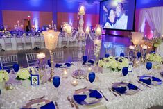 Our Royal Blue and White Wedding Bridal Party - Blue Wedding Reception Decor - Candelabras - Blue Goblets - Silver Chargers - Ivory Linen - Hydrangeas Roses Centerpieces - Family Styled Reception Seating - Black African American Elegant Wedding Silver Wedding Decorations, Blue Wedding Centerpieces, Silver Centerpiece, Wedding Reception Table Decorations, Wedding Themes, Wedding Colors, Wedding Blue, Reception Ideas, Wedding Ideas