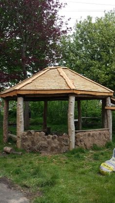 Rustic hand built roundhouse with a cedar shingle roof.