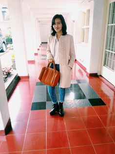 Fashion Blogger // Wearing: boots, acid jeans, white shirt, nude blazer, and fav bag