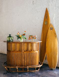 Tip for designing a bohemian tropical wedding? Sprinkle in a touch of vintage interest, like some cool surf boards and a midcentury bamboo bar.