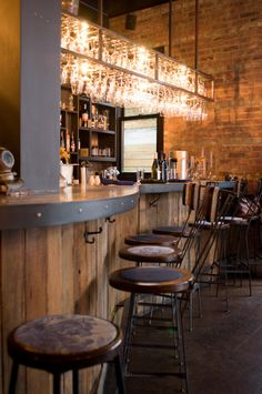 ABOVE BAR GLASS RACK - BRASS  RECLAIMED WOOD BAR - VERTICAL PLACEMENT.   The Castello Plan | Brooklyn