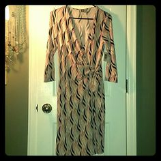 Anne klein wrap dress Long sleeve, perfect fall colors.  V neck, ties in front. Would be cute with boots or high heels. New with tags, never worn. Black, tan, peach, coral color blend. Anne Klein Dresses Long Sleeve
