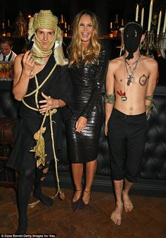 Who's your friends? Elle looked like she was having fun with two bizarrely-dressed actors ...