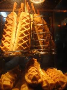 Hot dog in a waffle on a stick