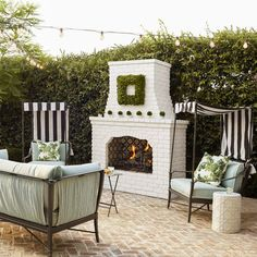 herringbone brick with white painted fireplace: House of Turquoise: Waterleaf Interiors Architectural Landscape Design Outdoor Seating Areas, Outdoor Rooms, Outdoor Living, Outdoor Furniture Sets, Outdoor Decor, Indoor Outdoor, Outdoor Fireplace Designs, Backyard Fireplace, Backyard Patio
