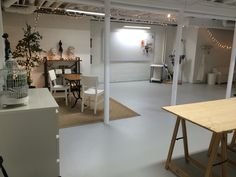 Art studio in semi finished basement, spray paint ceiling white