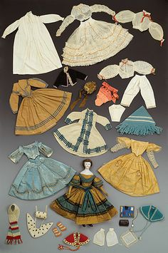 1860s doll with extensive wardrobe, including an ermine cloak and muff, and with the same exaggerated proportions popular among women of the day.
