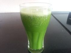 Amazing fruit juice with fresh ingredients, Spinach, Celery, cucumber, kiwi, apples and parsley.