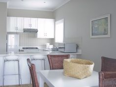 Kenjockity luxury 1 bed and 2 bed self-catering holiday apartment accommodation in Hermanus along the Garden Route of South Africa. Built In Braai, Door Opener, Open Plan Kitchen, Kitchen Utensils, Cutlery, Sliding Doors, Kettle, Refrigerator, Stove