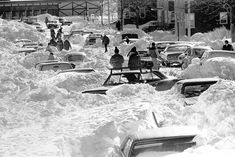 The Blizzard of 1978 dropped an all-time record 27 inches of snow on Boston. Here, residents of Farragut Road in South Boston are digging out their cars from snowdrifts. (AP)