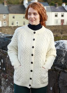 3f13460e4b0e64 An authentic handknit Aran Lumber cardigan beautifully designed with a rounded  neckline