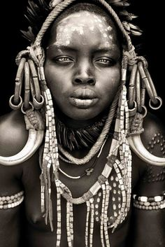 This is a mursai tribal headdress.  AT times I feel sooo White. So used to our clean idea of beauty. She reminds me to EMBRACE the beauty in all our cultures. Love this.