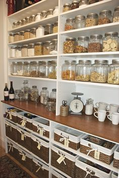 Beautifully organised pantry with wicker baskets and jars