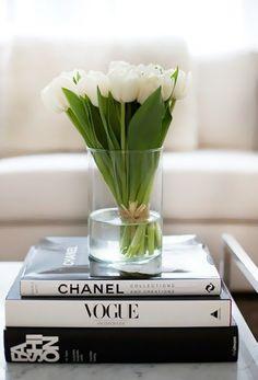 tulip - love the idea of putting a vase on designer books