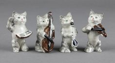 """Lot 62, A Beswick cat band comprising a conductor, an oboe player, a saxophonist and a violinist 2"""", est  £50-100"""