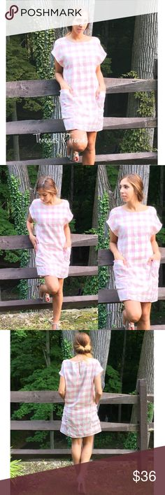 Pretty In Pink Plaid Shift Dress Fun & flirty pink & white plaid shift dress featuring two front pockets and key hole closure in back. Pair with white sneakers for casual wear or dress it up with strappy heals for a night out Dresses