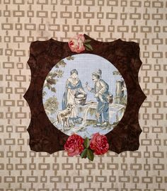 Large frame hand applique with broderie perse and toile print center. Wall art by Darla Hanks.