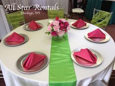 Hot pink napkins, lime green runner, and ivory linen wedding/shower round table. Silver charger plates, and silver chiavari chairs with lime green sashes. Perfect for an adorabe and unique baby shower or summer wedding!